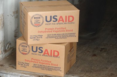 09-04-10bg_the_last_few_boxes_of_usaid_food_in_the_container